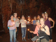 Goddess Pilgrims Light Candles After Meditating in the Darkness of the Skoteino Cave