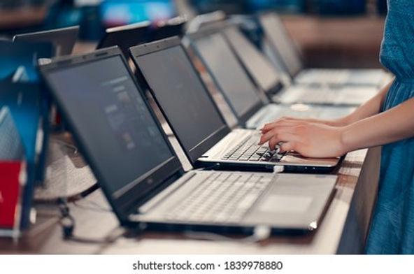 young-girl-testing-laptop-electronics-260nw-1839978880.jpeg