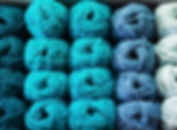 close up view on wool knitting balls in different blue colors.jpg