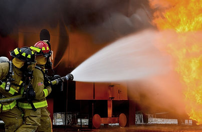 firefighters at a burning building