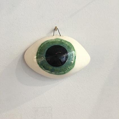 Grand œil bleu vert