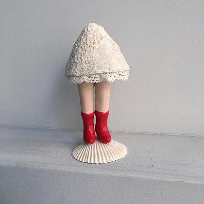Miss coquillage à bottes rouges