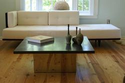 Graphite table and Landing Pad sofa