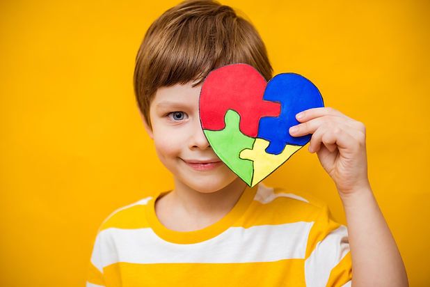 Kid boy hands holding puzzle heart, chil