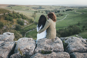 Bride and groom look out over the Yorkshire Dales from the top of Malham Cove during their elopement | wedding photo by Sam Chipman Photography