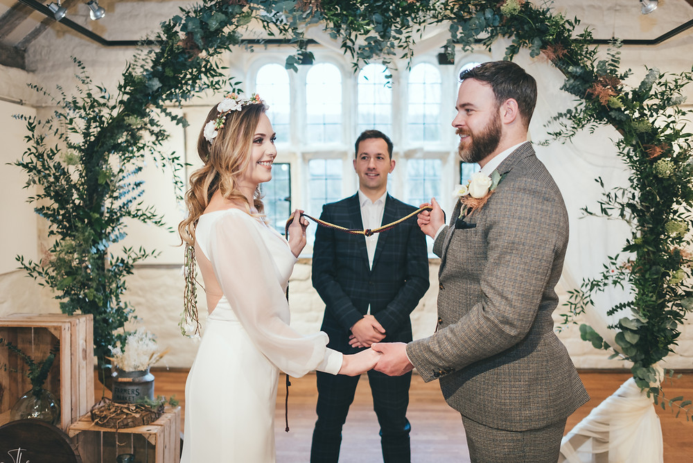 Bride and groom tie the knot at sustainable wedding.
