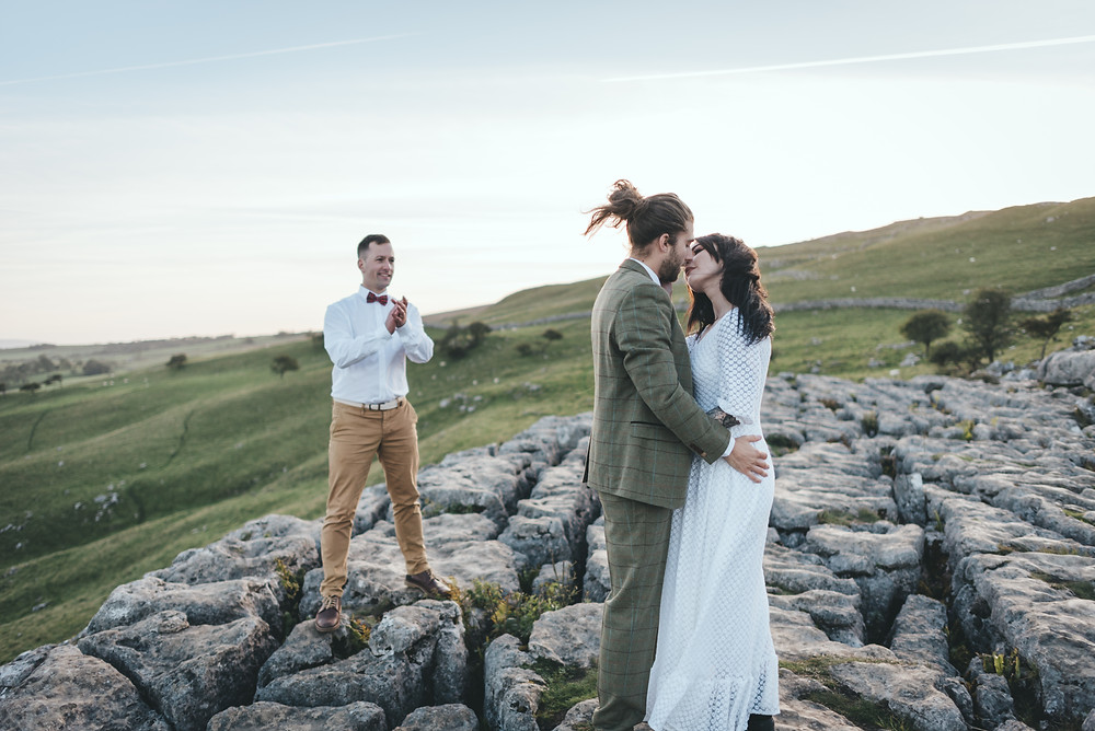 Bride and groom share a kiss after getting married at Malham Cove