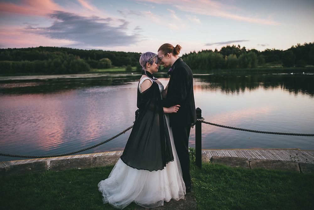 Bride & Groom by the lake at Waterton Park Hotel in Wakefield