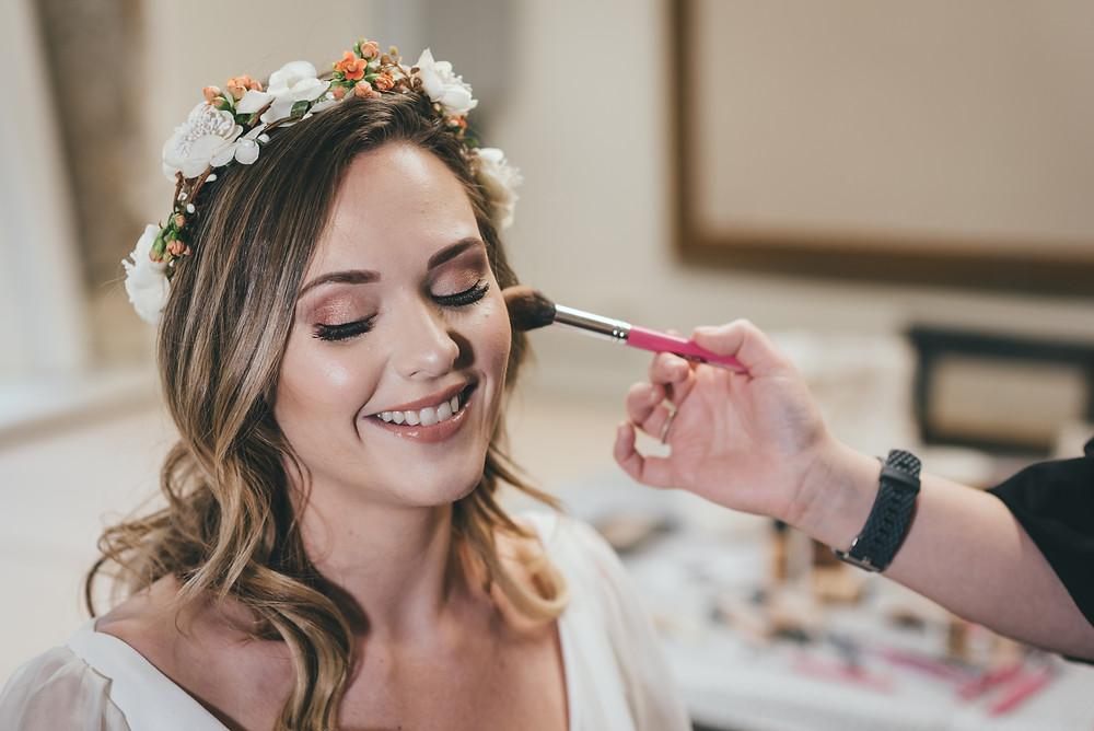 Bride gets her makeup done.