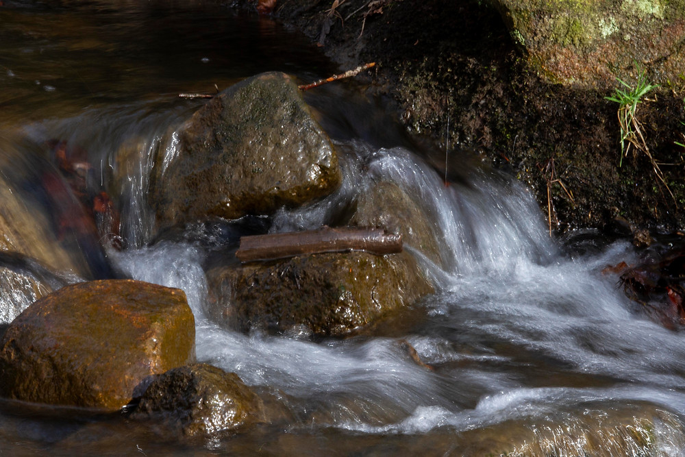 Image created at Lumsdale Falls, Matlock, experimenting with long exposure handheld.