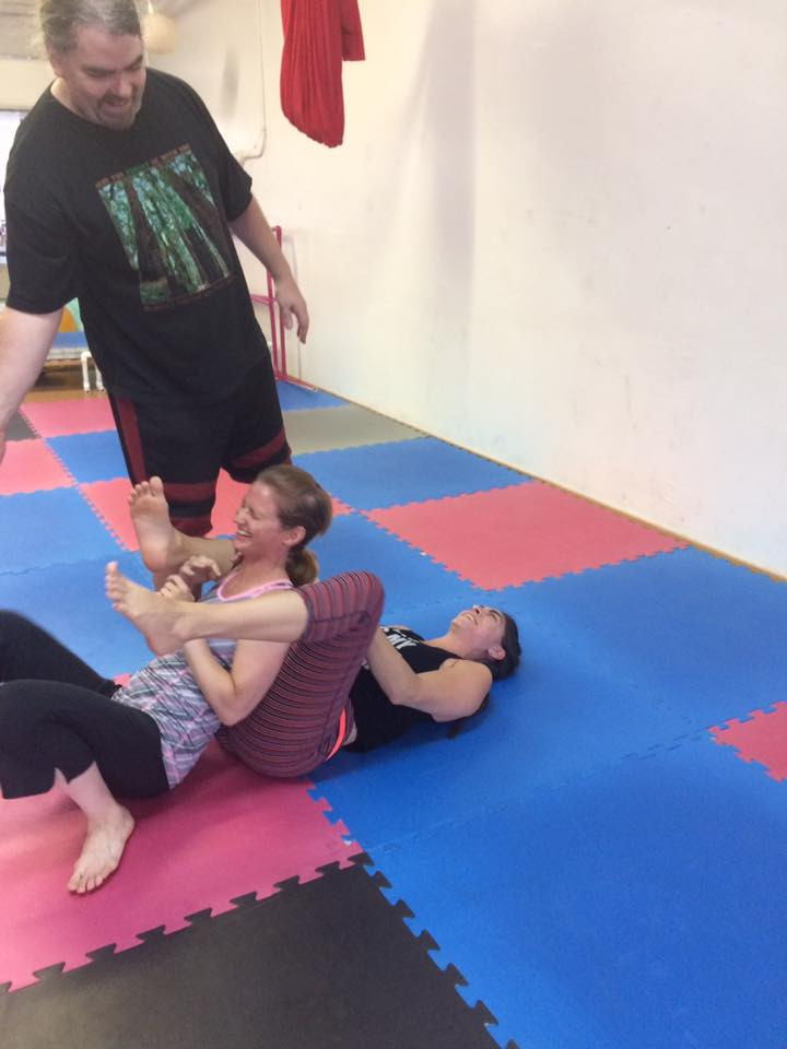 An Acroyoga pose gone awry.... Note the smiles all around!