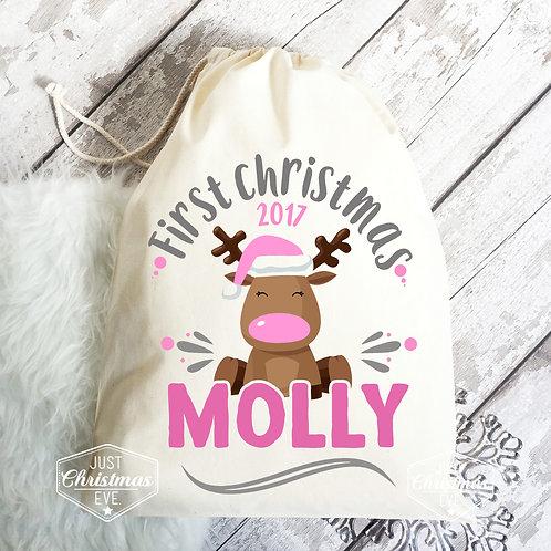 First Christmas gift bag for a baby girl.