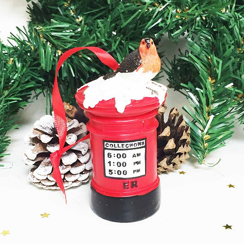 Red post office mail box and robin Christmas decoration