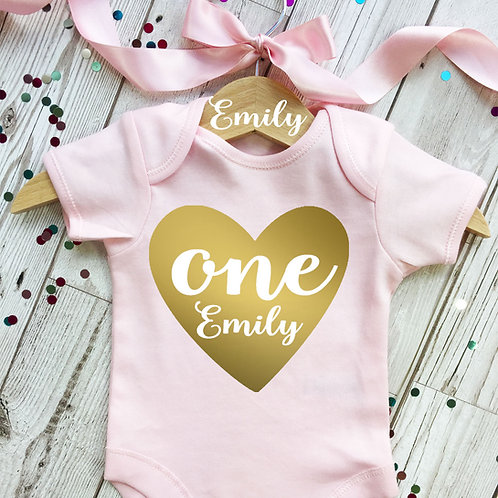 Baby girl first birthday onesie and wooden hanger. Gold hanger.