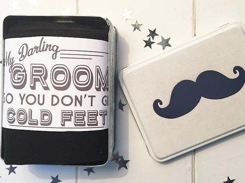 Groom socks in a tin