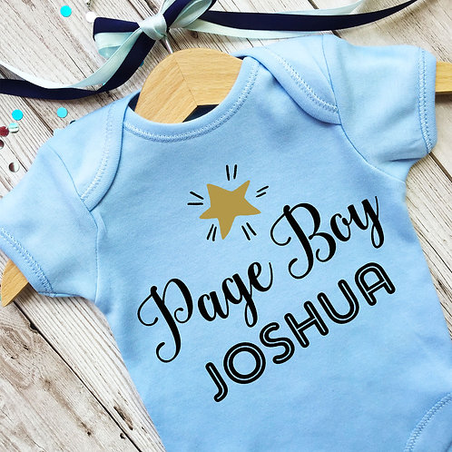 Page boy blue baby grow with wooden hagere gift.