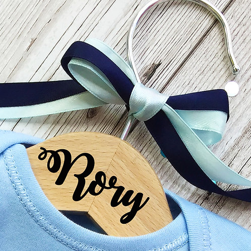 Personalised wooden hanger for a boy.