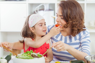 How can I encourage my child to taste new foods?