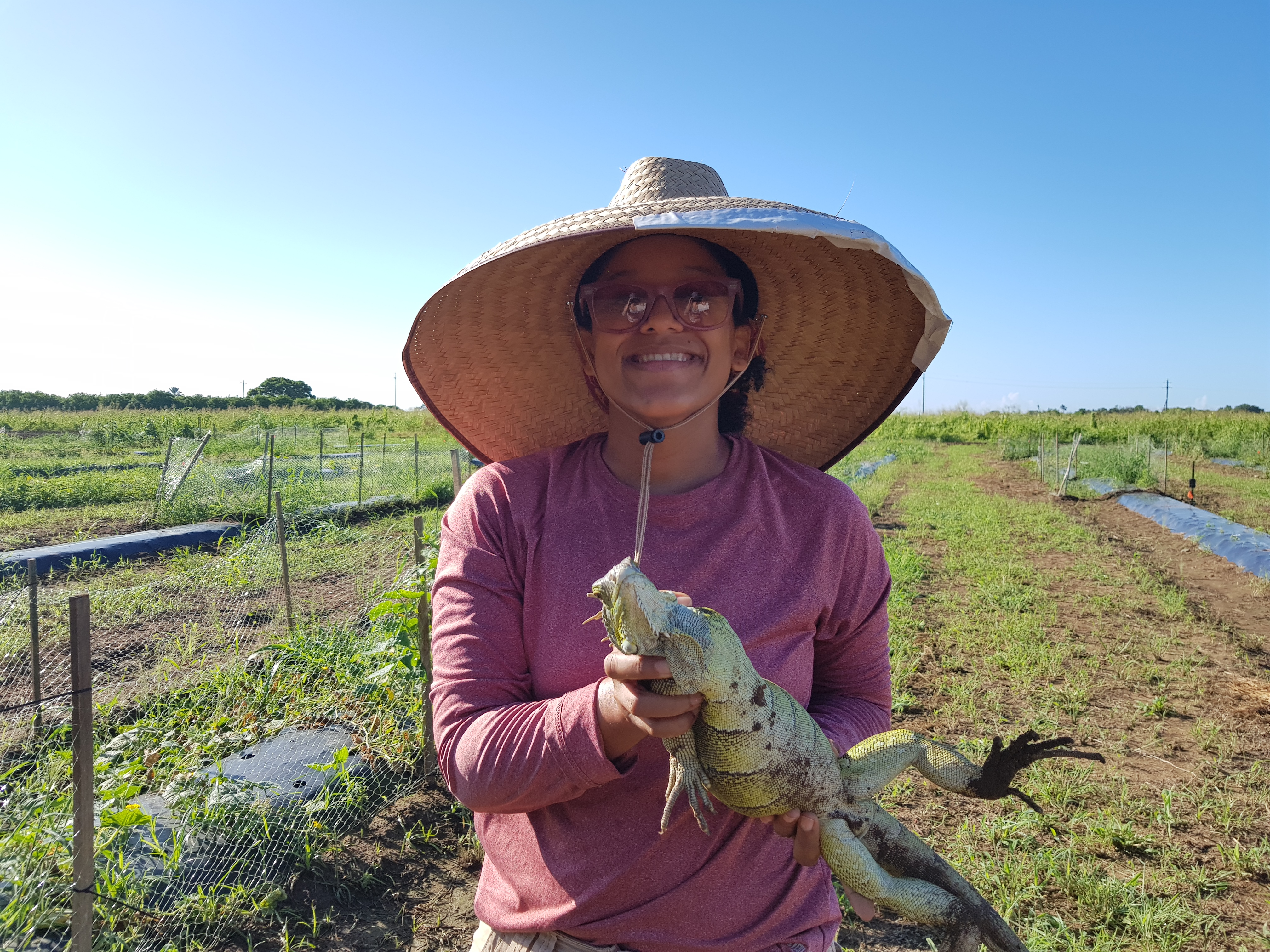 Christina holds iguana