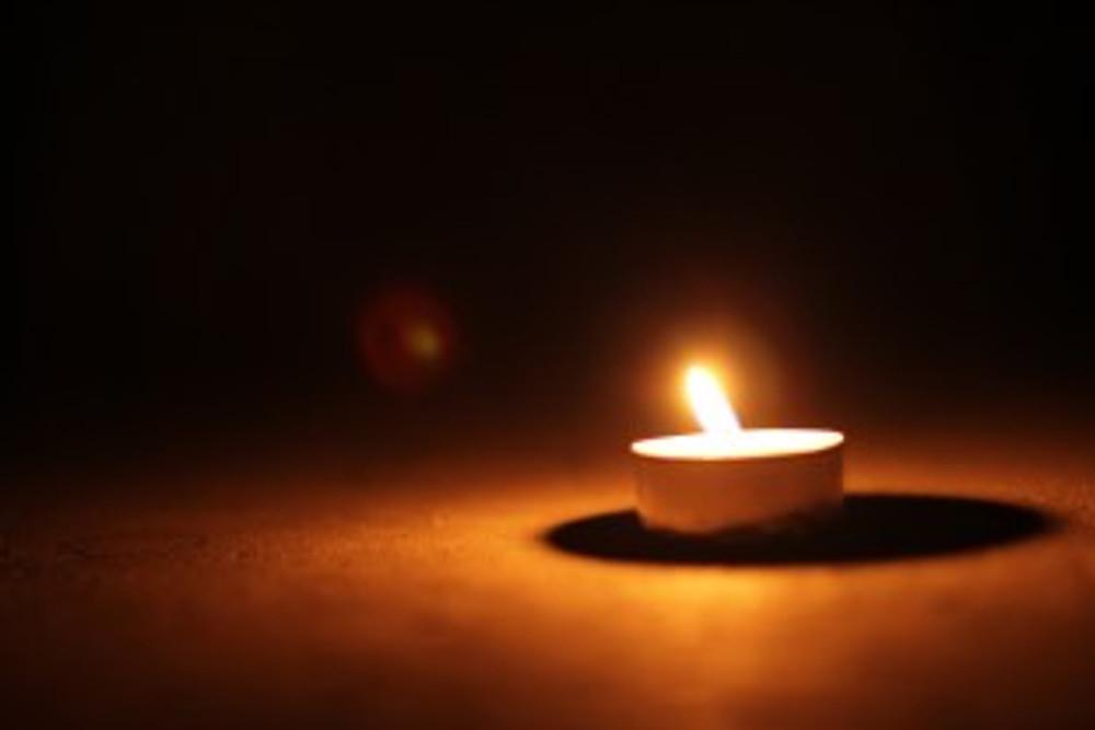Single tealight candle on dark background - 'Light Licht' by manoftaste licenced under CC BY 2.0