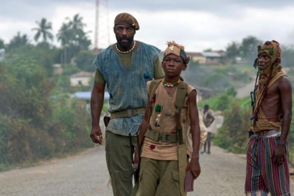 Caption: Idris Elba and Abraham Attah in 'Beasts of No Nation', a Netflix Original Film.