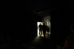 Audience travel through hidden door