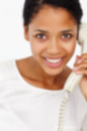 Woman talking on telephone.jpg