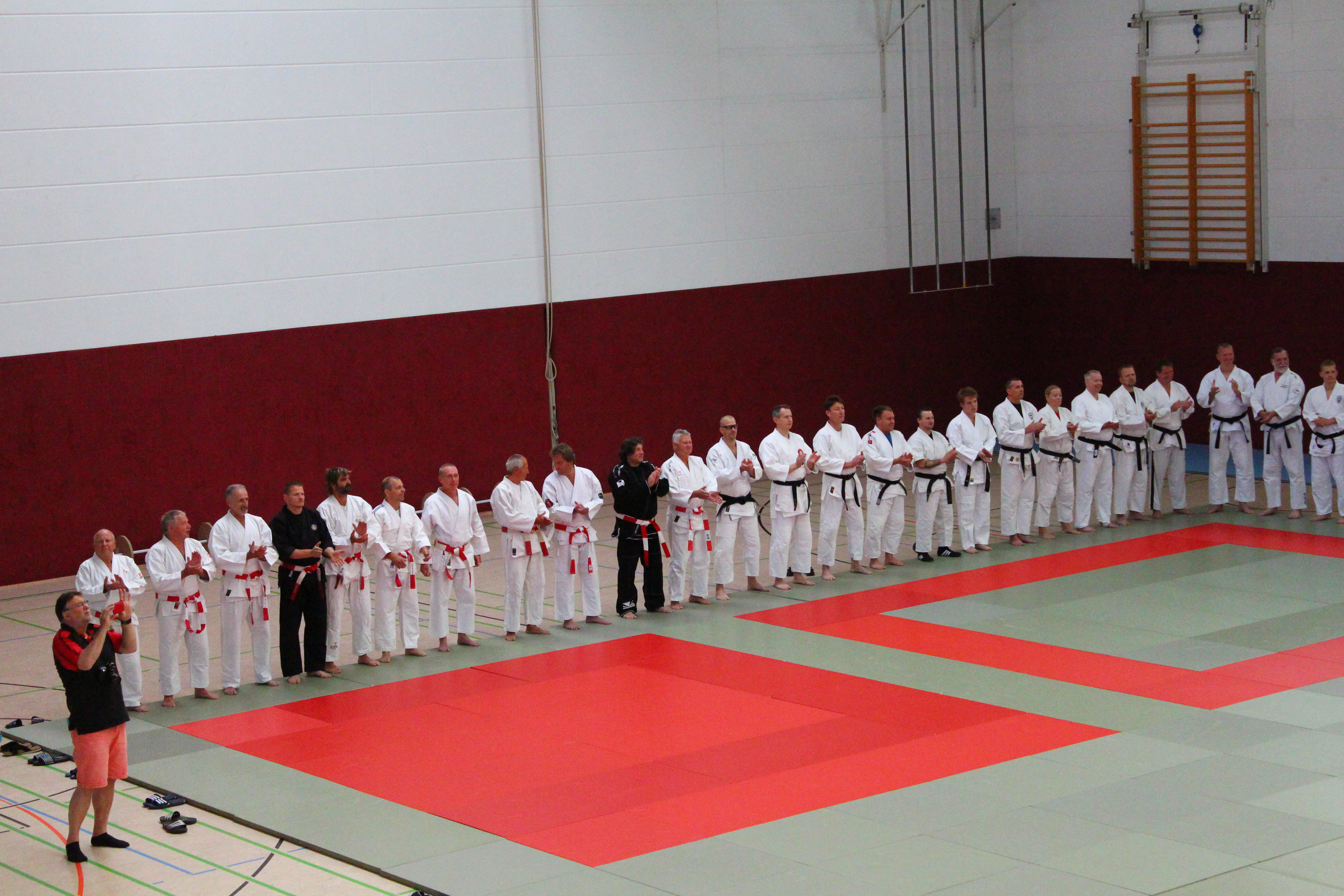 Lots of people, large mat