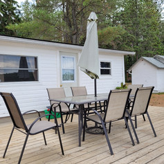 Private deck with patio furniture, umbrella and gas BBQ