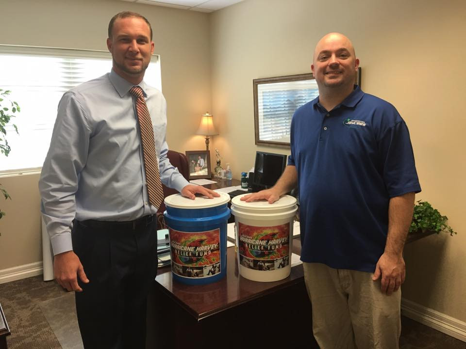 Dustin Beavers, Jaycees Treasurer, and Richard Shade, Jaycees Past President, pose for a photo with the Jaycees Hurricane Harvey Relief coin collection buckets. Donations will be collected through the end of September at Austin Bank, 3120 North St., and Commercial Bank of Texas, 215 E Main St.