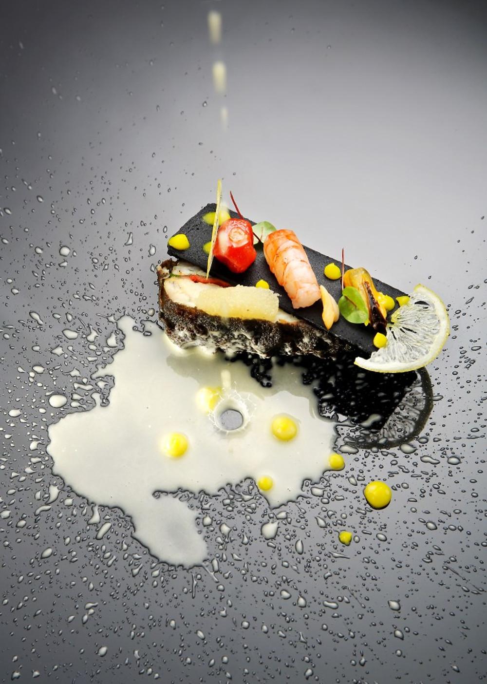 Turbot steak with sautéed seafood in Amalfitan lemon sauce_c