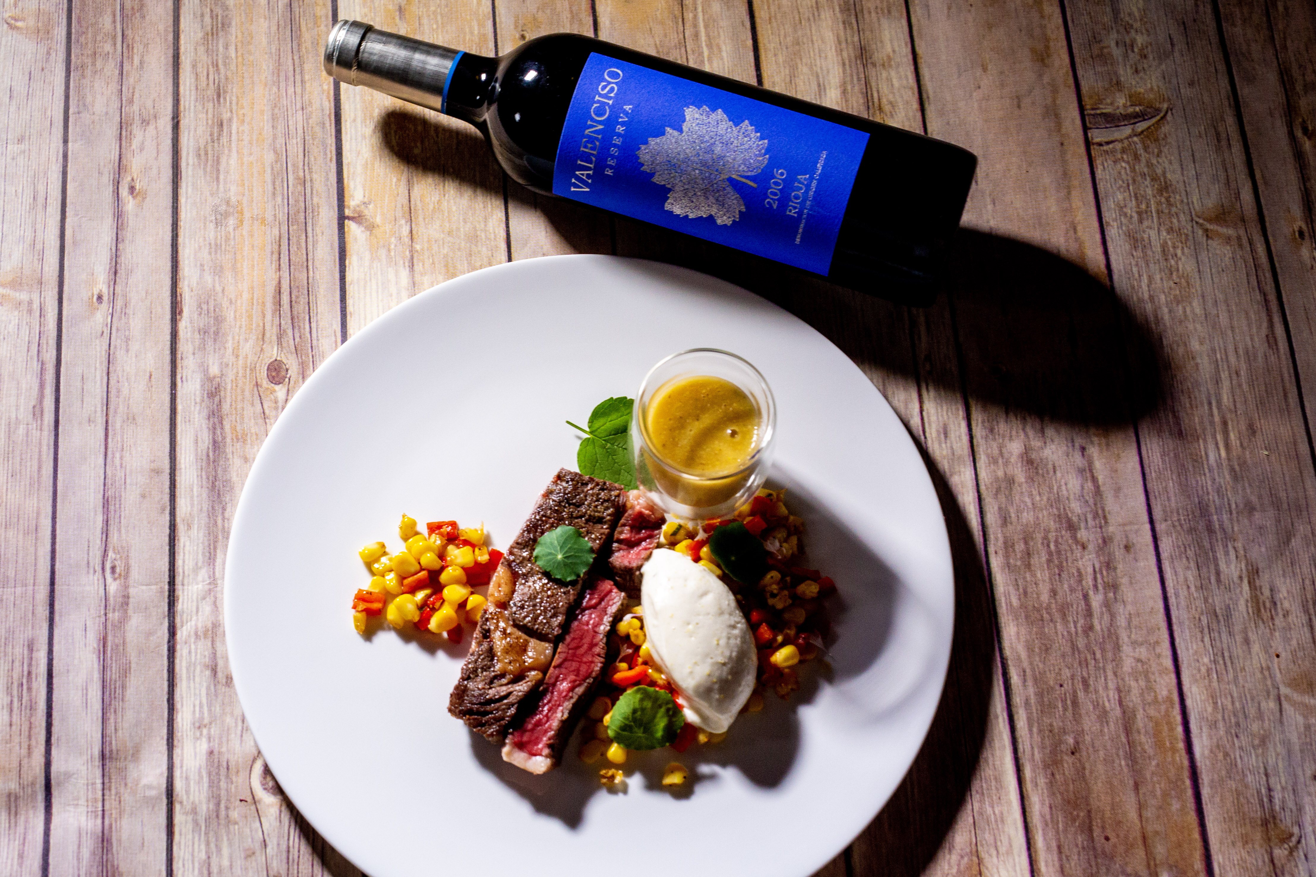 A bottle of wine and a steak   Chef & Somm