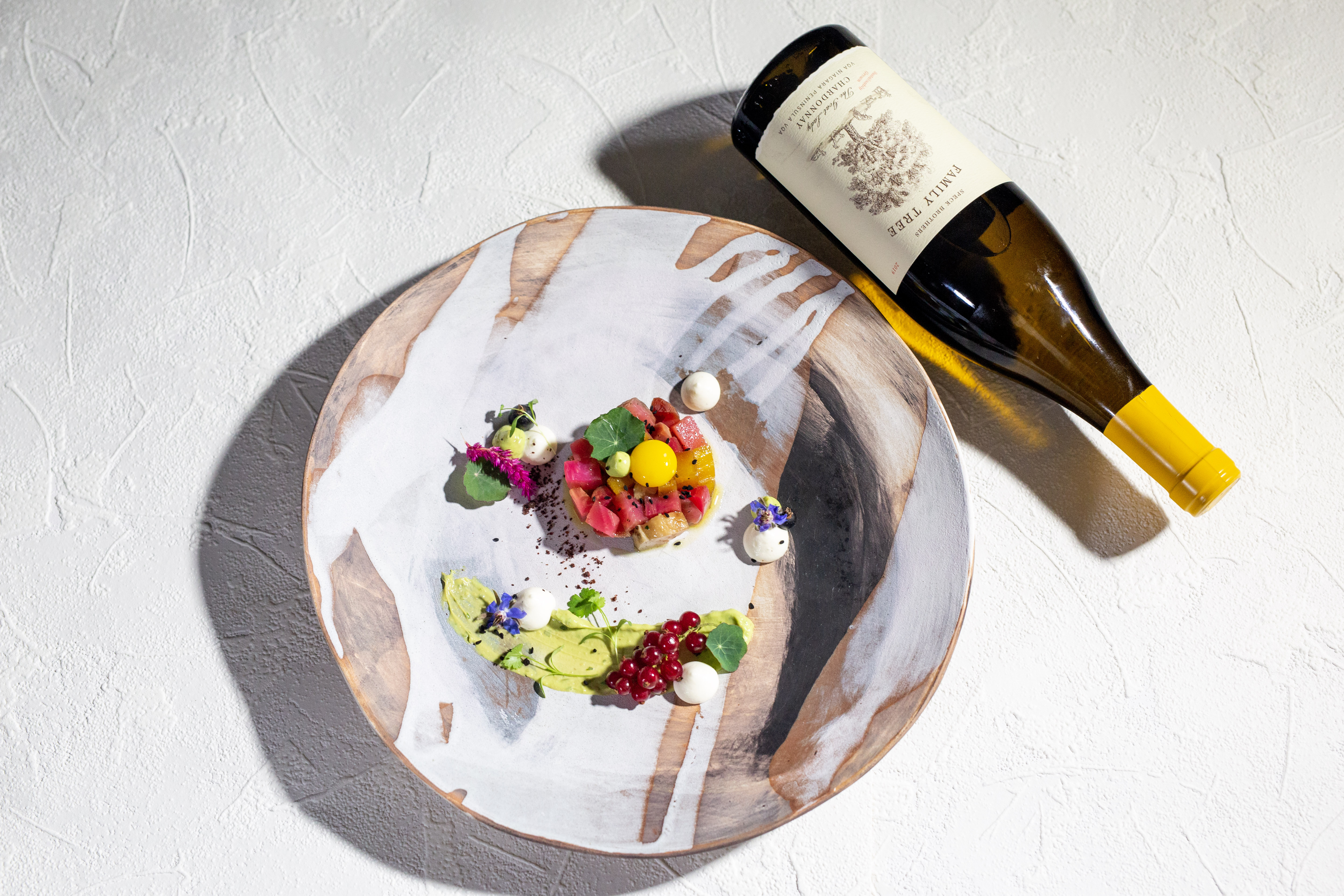 A bottle of wine and food   Cheff & Somm