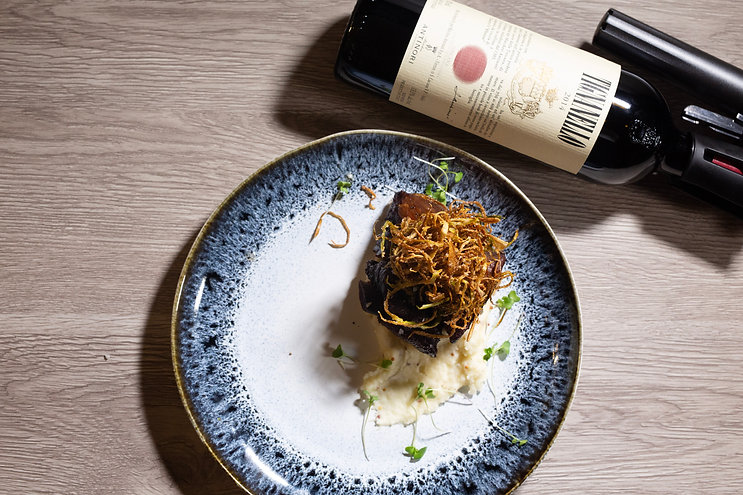 A bottle of wine and a plate with food   Chef & Somm
