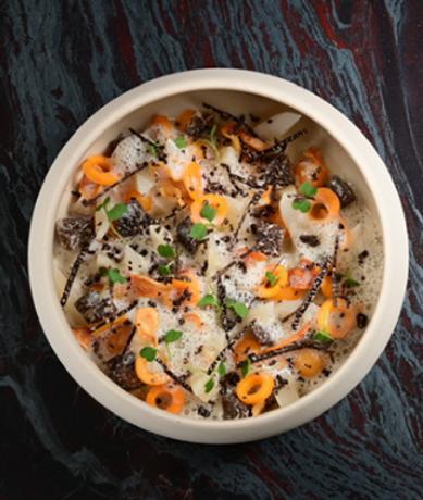 Royale de légumes d'hiver aromatisés aux truffes noires