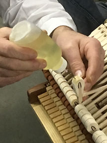 Piano technician doing voicing work on a piano's hammers
