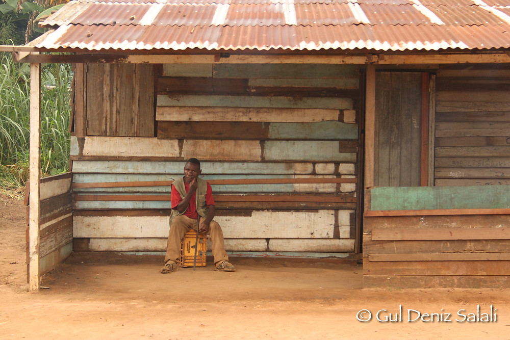 An Mbendjele man in front of his house in the town camp we visited. He works for the local radio station.