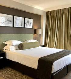 Belaire Suites Hotel Double Bed.jpg