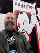 Jeff in Front of the Imaginos Banner
