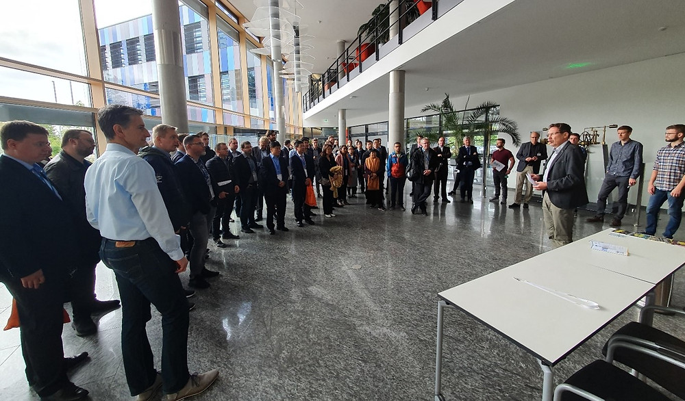 Figure 3: Participants of the conference at the entrance hall of the Fraunhofer Institute for Applied Optics and Precision Engineering IOF