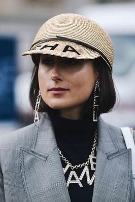 Girl w Chanel straw hat and neckalce.jpg