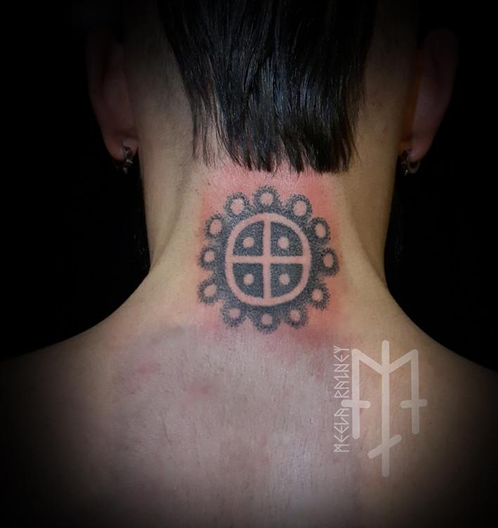 Sun petroglyph tattoo
