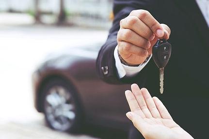 businessman-hand-holding-car-keys-front-