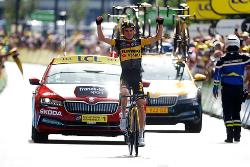 Photo by Chris Graythen/Getty Images of Sepp Kuss winning Stage 15 of Tour de France