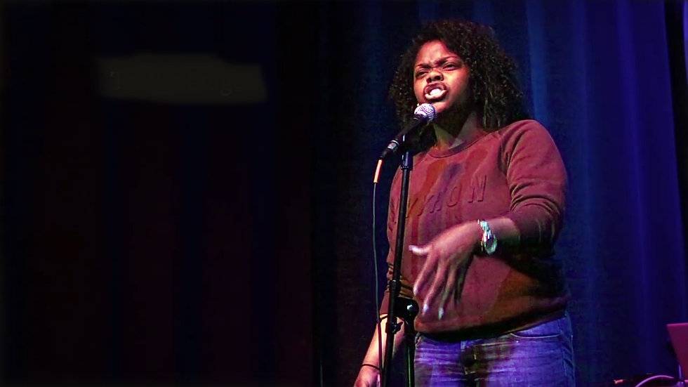 High school poet performs on stage