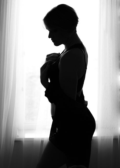 Pixie cut window standing silhouette