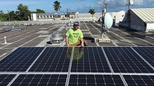 Brennan Schumacher with Solar Panels.jpg