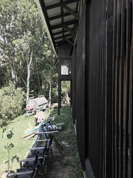 Carpentry | Charred hardwood  Sliding exterior screens to reading nook 2018 -- Architecture @stuart_vokesandpeters