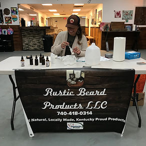A local artisan making custom body care products during an in-store event at Silo Ridge Makers Market.