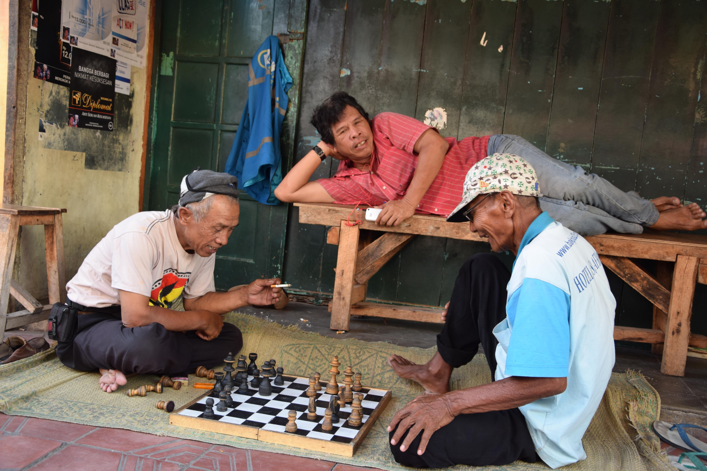 Old man playing chess, Yogyakarta